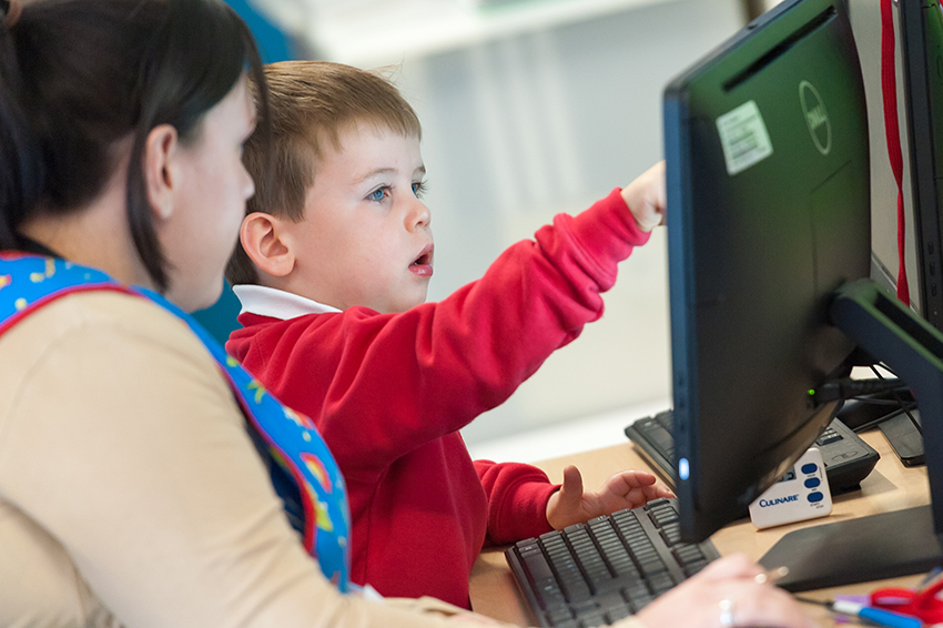 young boy at computer