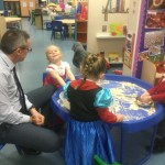 Some of the  children tell Mr Jones the story of Goldilocks on one of his visits to Nursery.