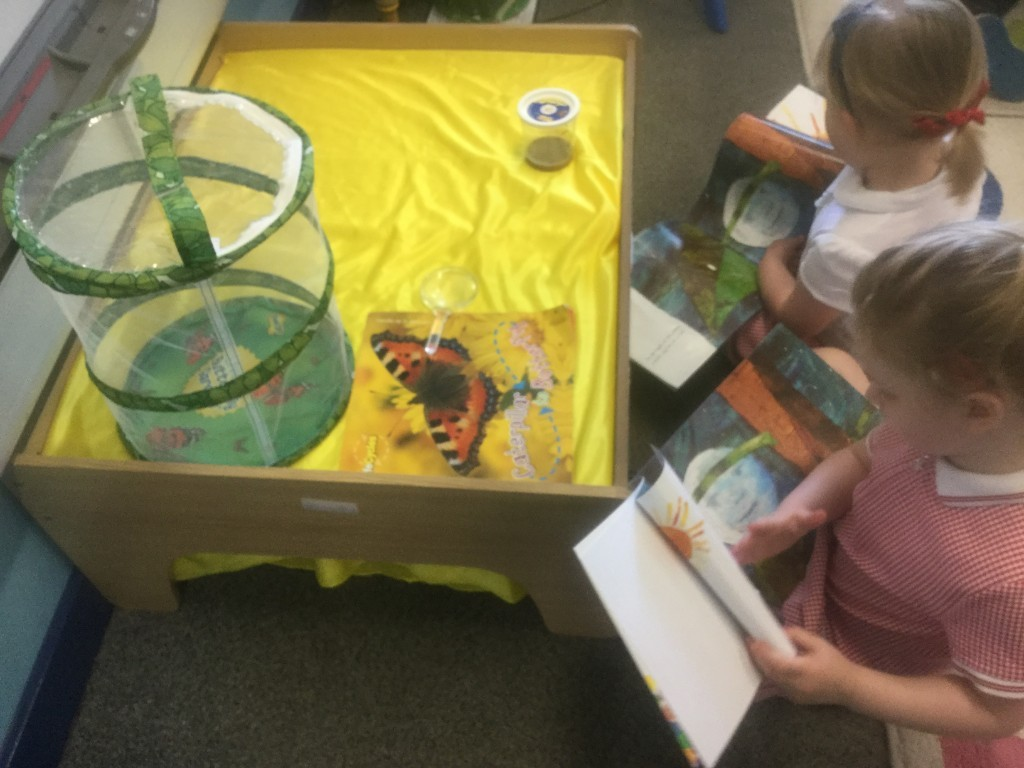 Reading 'The Very Hungry Caterpillar'.